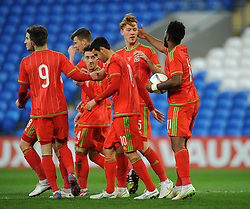 Josh Yorweth of Wales u21s (Cardiff City) celebrates with his team mates after scoring to make it 3-0 - Photo mandatory by-line: Dougie Allward/JMP - Mobile: 07966 386802 - 31/03/2015 - SPORT - Football - Cardiff - Cardiff City Stadium - Wales v Bulgaria - U21s International Friendly