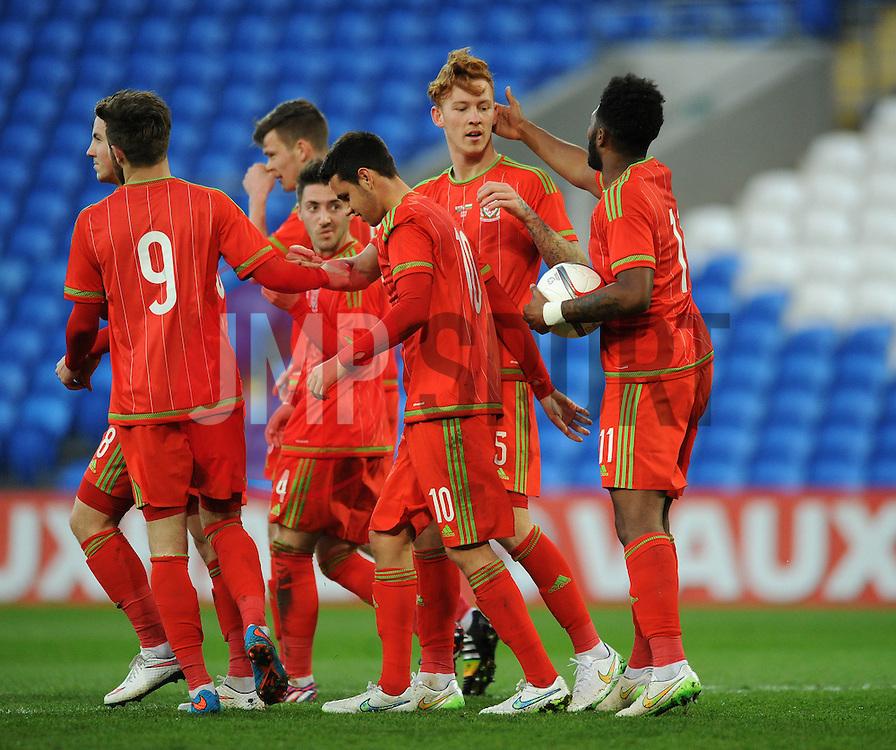 Josh Yorweth of Wales u21s (Cardiff City) celebrates with his team mates after scoring to make it 3-0 - Photo mandatory by-line: Dougie Allward/JMP - Mobile: 07966 386802 - 31/03/2015 - SPORT - Football - Cardiff - Cardiff City Stadium - Wales v Bulgaria - U21s International Friendly