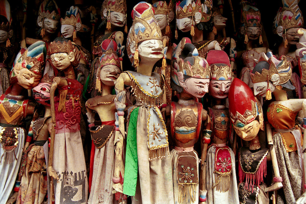 Warang puppets in a street vendor's stall on a main thoroughfare in Yogyakarta, Java, Indonesia.