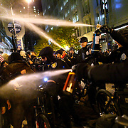 Seattle Police officers deploy pepper spray into a crowd during an Occupy Seattle protest on Tuesday, November 15, 2011 at Westlake Park. Protesters gathered in the intersection of 5th Avenue and Pine Street after marching from their camp at Seattle Central Community College in support of Occupy Wall Street. Many refused to move from the intersection after being ordered by police. Police then began spraying into the gathered crowd hitting dozens of people. A pregnant woman was taken from the melee in an ambulance after being struck with spray. An 84 year-old activist was also hit with spray. (Joshua Trujillo, seattlepi.com)