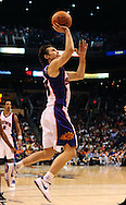 Jan. 6 2010; Phoenix, AZ, USA; Phoenix Suns guard Steve Nash (13) puts up a shot against the Houston Rockets at the US Airways Center. Phoenix Suns defeated the Houston Rockets 118-110.  Mandatory Credit: Jennifer Stewart-US PRESSWIRE