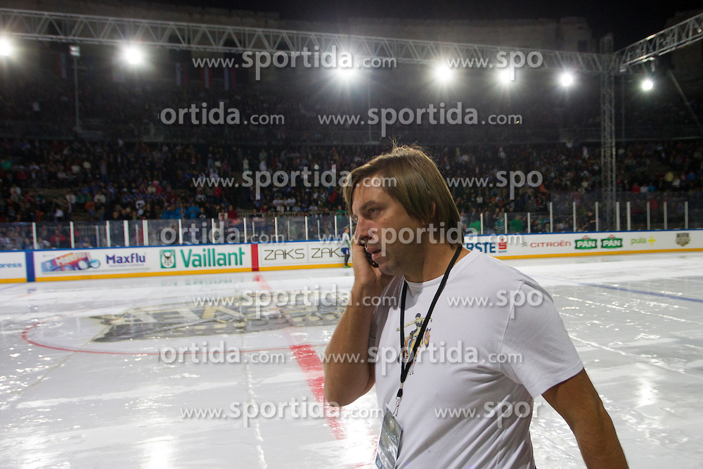 14.09.2012. Pula Arena, Pula, CRO, EBEL, KHL Medvescak Zagreb vs HDD Telemach Olimpija Ljubljana, 03. Runde, in picture Damir Gojanovic, owner of KHL Medvescak Zagreb, checking the ice as the game is delayed because of the problems with ice before the Erste Bank Icehockey League 3rd Round match between KHL Medvescak Zagreb and HDD Telemach Olimpija Ljubljana at the Pula Arena, Pula, Croatia on 2012/09/14. (Photo By Matic Klansek Velej / Sportida)