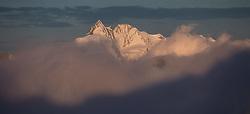 THEMENBILD - Gipfel des Grossglockner (3798m) ragt wärend dem Sonnenaufgang aus einer geschlossenen Nebeldecke, aufgenommen am 7. Oktober 2014 // Summit of the Grossglockner (3798m) over a closed blanket of fog moment during the sunrise, Pictured on October 7, 2014. EXPA Pictures © 2014, PhotoCredit: EXPA/ Johann Groder