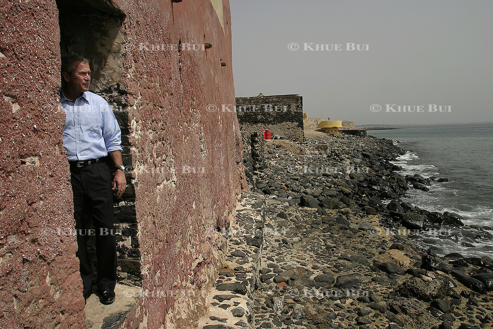 "President Bush looks out from the ""Door of No Return"" Tuesday, July 8, 2003, on Goree Island, Senegal.  The door is the point where many Africans were sent as slaves to America or to their death in the ocean waters...Photo by Khue Bui"