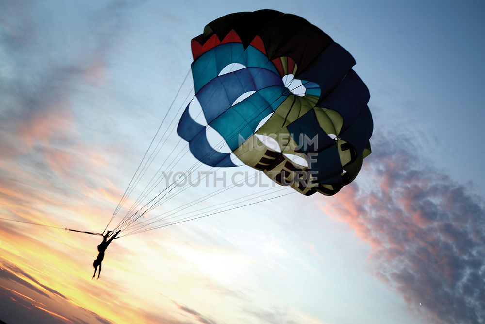 A person paragliding whilst upside down at sunset, Cafe del Mar, Ibiza, 2006