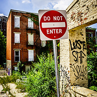 """Do Not Enter Sign at Glencoe Auburn Place Picture. Known as """"The Hole"""" the complex was abandoned and in very poor condition for years.  The Glencoe-Auburn Place Row Houses were built in the late 1800's and were listed on the U.S. National Register of Historic Places. Glencoe-Auburn Place was demolished in March 2013."""