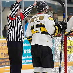 TRENTON, ON  - MAY 5,  2017: Canadian Junior Hockey League, Central Canadian Jr. &quot;A&quot; Championship. The Dudley Hewitt Cup. Game 7 between The Georgetown Raiders and The Powassan Voodoos. OHA Referee makes the call during the second period <br /> (Photo by Amy Deroche / OJHL Images)