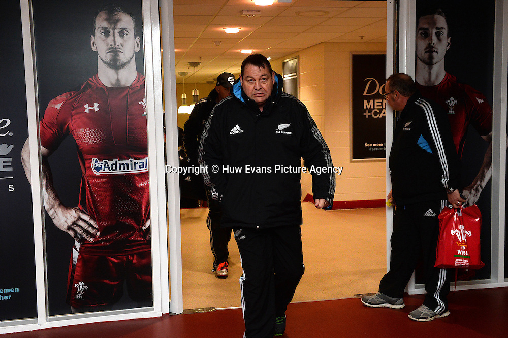 21.11.14 - New Zealand All Blacks Rugby Training -<br /> Steve Hansen walks past a poster of Sam Warburton and George North.<br /> &copy; Huw Evans Picture Agency