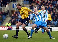 Photo: Scott Heavey.<br />Oxford United v Huddersfeild Town. Nationide Division Three. 06/03/2004.<br />James Hun of Oxfordt holds off Tony Carss (R)