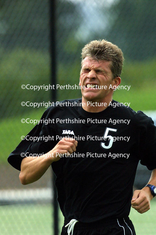 St Johnstone resume training...29.06.01<br />The pain shows on St Johnstone skipper Jim Weir's face on the first day back in training after the summer break<br /><br />Pic by Graeme Hart<br />Copyright Perthshire Picture Agency<br />Tel: 01738 623350 / 07990 594431<br />30 James Street, Perth. Perthshire. Scotland. PH2 8LZ