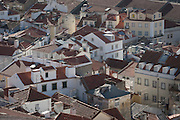 Aerial view of rooftops in the medieval district of Alfama, in Lisbon, Portugal.
