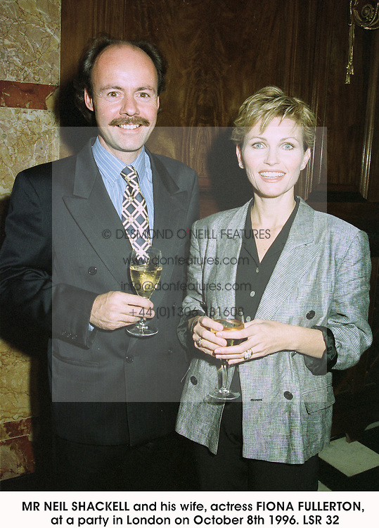 MR NEIL SHACKELL and his wife, actress FIONA FULLERTON, at a party in London on October 8th 1996.LSR 32