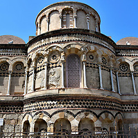 Western Fa&ccedil;ade of Annunziata dei Catalani Church in Messina, Italy <br /> Calling the western fa&ccedil;ade of the Annunziata dei Catalani Church magnificent is an understatement. This is a masterful blend of Byzantine, Moorish and Romanesque architectural elements. It was built in the late 13th century on top the Temple of Neptune. It received its current name, Saint Annunciation of the Catalans, during the Aragonese period (14th - 15th centuries) when the official language of the royal court was Catalan.