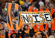 """Cincinnati Bengals fans hold up """"noise"""" and """"defense"""" signs during the Cincinnati Bengals NFL AFC Wild Card playoff football game against the Pittsburgh Steelers on Saturday, Jan. 9, 2016 in Cincinnati. The Steelers won the game 18-16. (©Paul Anthony Spinelli)"""