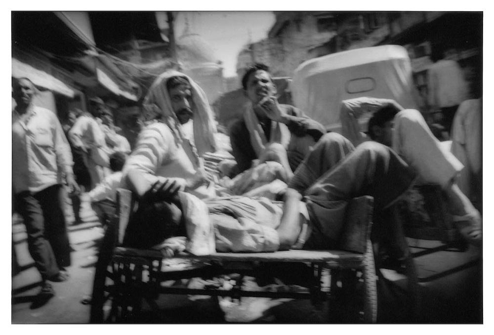Lounging in a rickshaw traffic jam, Dehli.