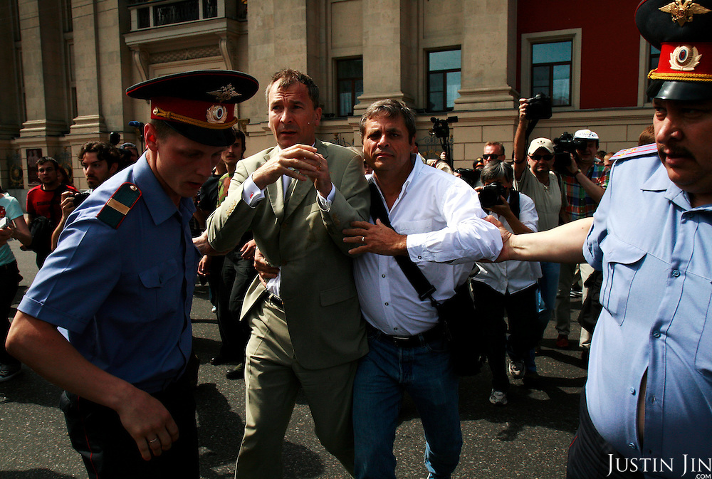 German parliarmentarian Volker Beck (left) and his partner Jacques Teyssier (right) are arrested by Russian police after authorities, nationalist protesters and Orthodox Christians forcefully prevented gay and lesbian rights activists from rallying in Moscow..Homosexuality was decriminalized in Russia in 1993. Moscow has repeatedly banned gay parades, including this one. .