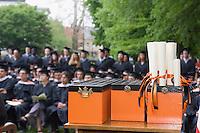 diplomas at a college graduation