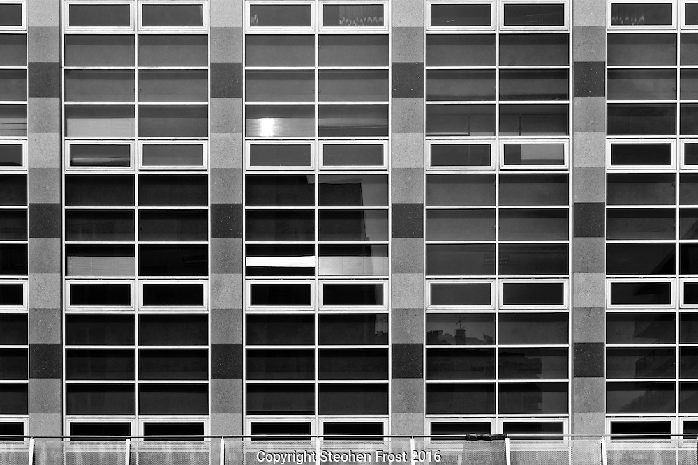 A rectangular pattern made by windows of a tower block in Lisbon, Portugal.