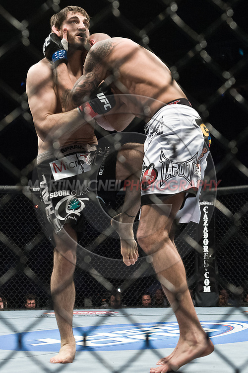 """NEWARK, NEW JERSEY, MARCH 27, 2010: Jon Fitch and Ben Saunders are pictured during their bout at """"UFC 111: St. Pierre vs. Hardy"""" in the Prudential Center, New Jersey on March 27, 2010"""