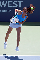 July 31, 2011; Stanford, CA, USA;  Marion Bartoli (FRA) serves the ball against Serena Williams (USA), not pictured, during the finals of the Bank of the West Classic women's tennis tournament at the Taube Family Tennis Stadium.