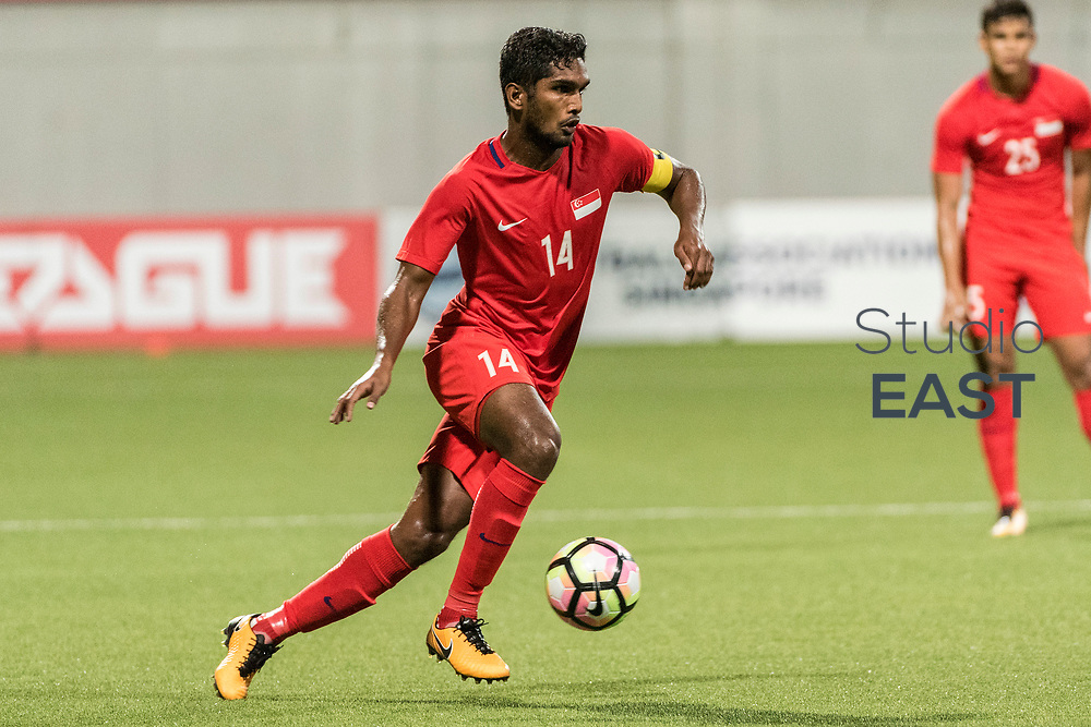 SINGAPORE, SINGAPORE - AUGUST 31: Hariss Harun of Singapore runs with the ball during the international friendly match between Singapore and Hong Kong at the Jalan Besar Stadium on August 31, 2017, in Singapore, Singapore. (Photo by Getty Images)