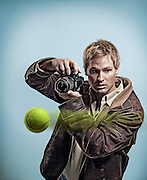 Photographer capturing tennis ball shot with Sony Alpha camera