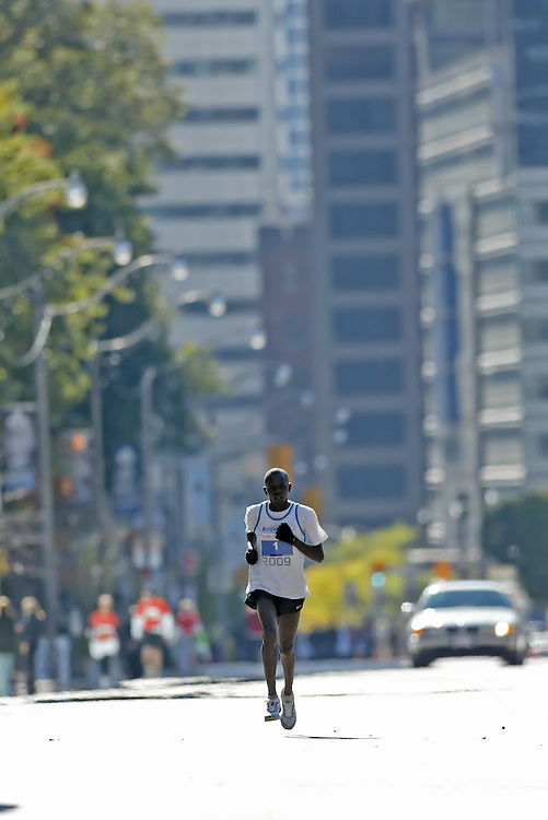"""(Toronto, Ontario -- 18 Oct 2009)   PAUL RUGUT on his way to victory  in the Goodlife Fitness Toronto Marathon. [Photo credit should read """"Sean Burges / Mundo Sport Images""""]"""