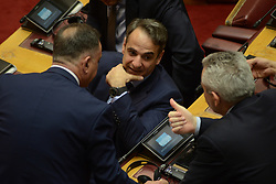 April 26, 2018 - Athens, Attiki, Greece - Kyriakos Mitsotakis leader of the main opposition and President of New Democracy party (centre), having a chat with deputies of his party, in Hellenic Parliament, while waiting the speech of President of the European Commission, Jean-Claude Juncker. (Credit Image: © Dimitrios Karvountzis/Pacific Press via ZUMA Wire)