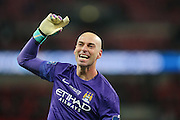 Manchester City goalkeeper Wilfredo Caballero (13)  celebrates winning the cup during the Capital One Cup match between Liverpool and Manchester City at Anfield, Liverpool, England on 28 February 2016. Photo by Simon Davies.