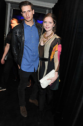 KATIE READMAN and TOM WARREN at the Warner Music Group Post Brit Awards Party in Association with Samsung held at The Savoy, London on 20th February 2013.
