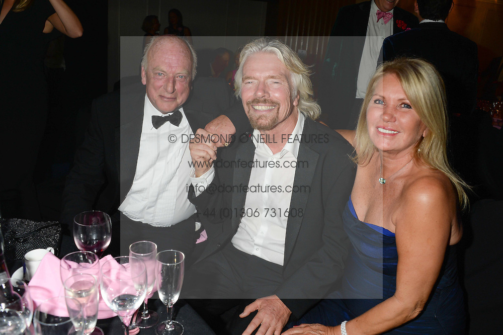 British fine jewellery brand Boodles welcomed guests for the 2013 Boodles Boxing Ball in aid of Starlight Children's Foundation held at the Grosvenor House Hotel, Park Lane, London on 21st September 2013.<br /> Picture Shows:-Left to right, BILL ANDREWES, SIR RICHARD BRANSON and LADY BRANSON.<br /> <br /> Press release - https://www.dropbox.com/s/a3pygc5img14bxk/BBB_2013_press_release.pdf<br /> <br /> For Quotes  on the event call James Amos on 07747 615 003 or email jamesamos@boodles.com. For all other press enquiries please contact luciaroberts@boodles.com (0788 038 3003)