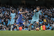 Chelsea's Cesc Fabregas makes a challenge on Nicolas Otamendi of Manchester City during the Premier League match between Manchester City and Chelsea at the Etihad Stadium, Manchester, England on 3 December 2016. Photo by Simon Brady.