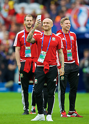 LILLE, FRANCE - Friday, July 1, 2016: Wales' David Cotterill takes a photo on his Apple iPhone on the pitch before the UEFA Euro 2016 Championship Quarter-Final match against Belgium at the Stade Pierre Mauroy. (Pic by David Rawcliffe/Propaganda)
