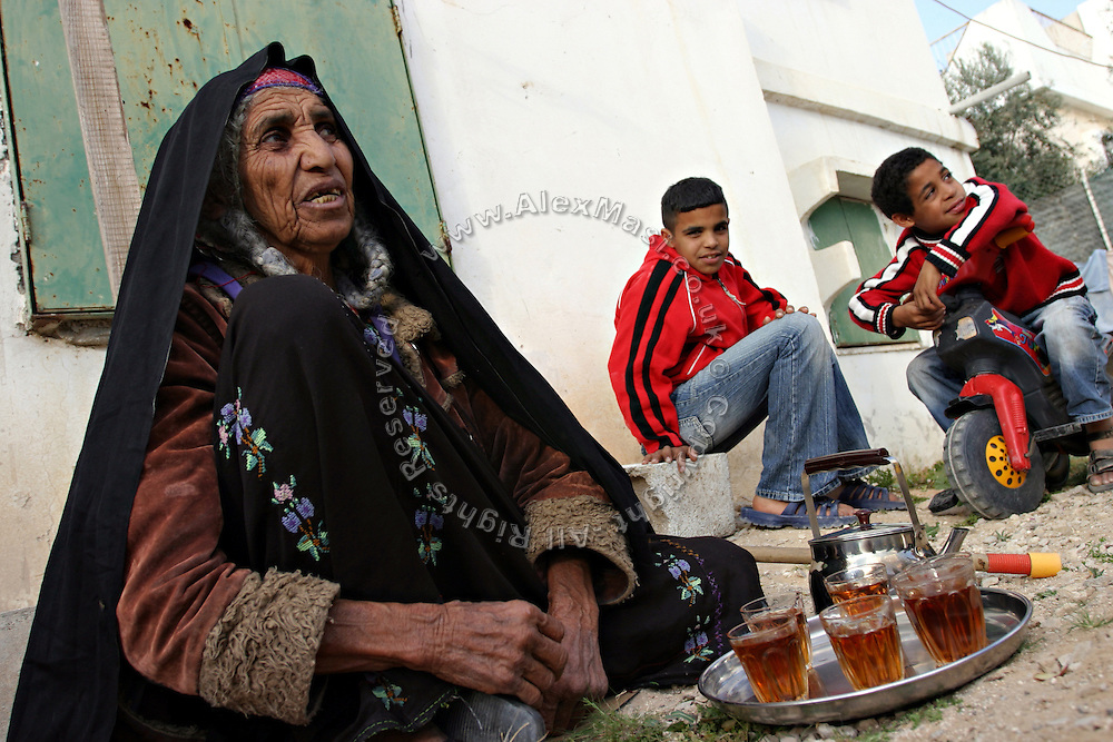 Temam, a 80-yeal-old Bedouin woman, is having tea in the Bedouin city of Rahat, close to BeerSheva, the capital of the Negev, a large deserted area in the south of Israel. Numbering around 200.000 in Israel, the Bedouins constitute the native ethnic group of these areas, they farm, grow wheat, olives and live in complete self sufficiency. Many of them were in these lands long before the Israeli State was created and their traditional lifestyle is now threatened by subtle Governmental policies. The seven Bedouin towns already built are all between the 10 more impoverished towns in Israel..