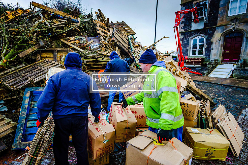 Biggar, South Lanarkshire, Scotland.  Final preparations at the Biggar hogmanay bonfire.  The fire will be lit at 9.30pm on hogmanay continuing a centuries old tradition and is possibly the largest new year bonfire in Britain.<br /> <br /> (c) Andrew Wilson   Edinburgh Elite media