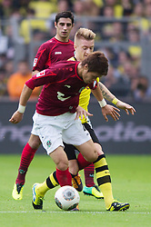 19.10.2013, Signal Iduna Park, Dortmund, GER, 1. FBL, Borussia Dortmund vs Hannover 96, 9. Runde, im Bild Zweikampf zwischen Hiroki Sakai (#4 Hannover), Marco Reus (#11 Dortmund)  // during the German Bundesliga 9th round match between Borussia Dortmund and Hannover 96 Signal Iduna Park in Dortmund, Germany on 2013/10/19. EXPA Pictures &copy; 2013, PhotoCredit: EXPA/ Eibner-Pressefoto/ Kurth<br /> <br /> *****ATTENTION - OUT of GER*****