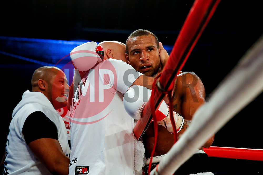 Bob Ajisafe (white shorts, black trim) celebrates after he beats Daniel Wanyonyi (black shorts, white trim) by 4th round knock out in a bout for the vacant Commonwealth Light Heavweigt Title - Photo mandatory by-line: Rogan Thomson/JMP - 07966 386802 - 13/06/2015 - SPORT - BOXING - Bristol, England - Action Indoor Sports Arena - Lee Haskins vs Ryosuke Iwasa - Interim IBF World Bantamweight Title Fight - UNDERCARD.