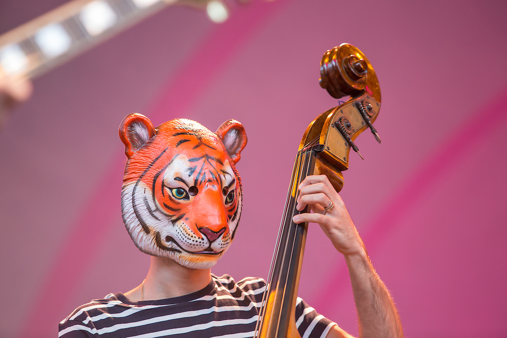 Bassist Petros Klampanis wore a tiger mask through much of the band's performance.