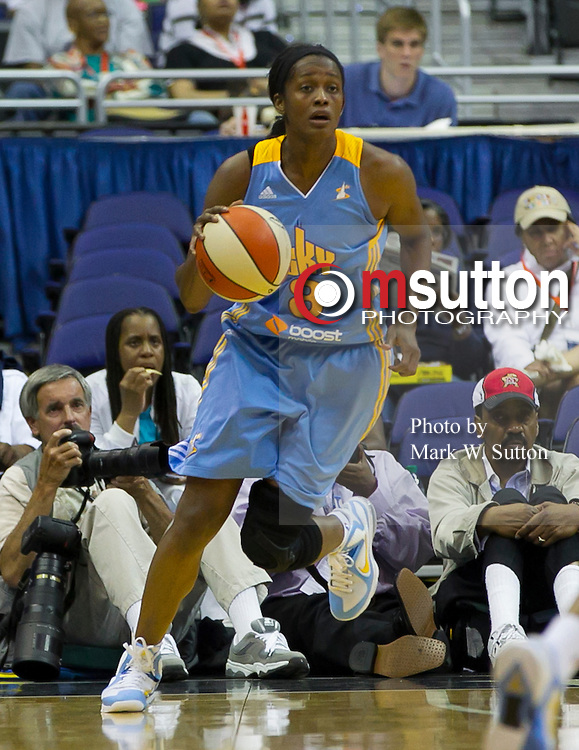 Chicago Sky forward Swin Cash (8) brings the ball up the court during the first half of this WNBA game between the Mystics and the Sky at the Verizon Center in Washington, DC.  The Sky won 69 - 57.  May 19, 2012  (Photo by Mark W. Sutton)