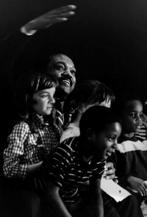 Surround onstage by children, Reverend Jesse Jackson campaigns across the south in his 1984 bid to be the first African American president of the United States.