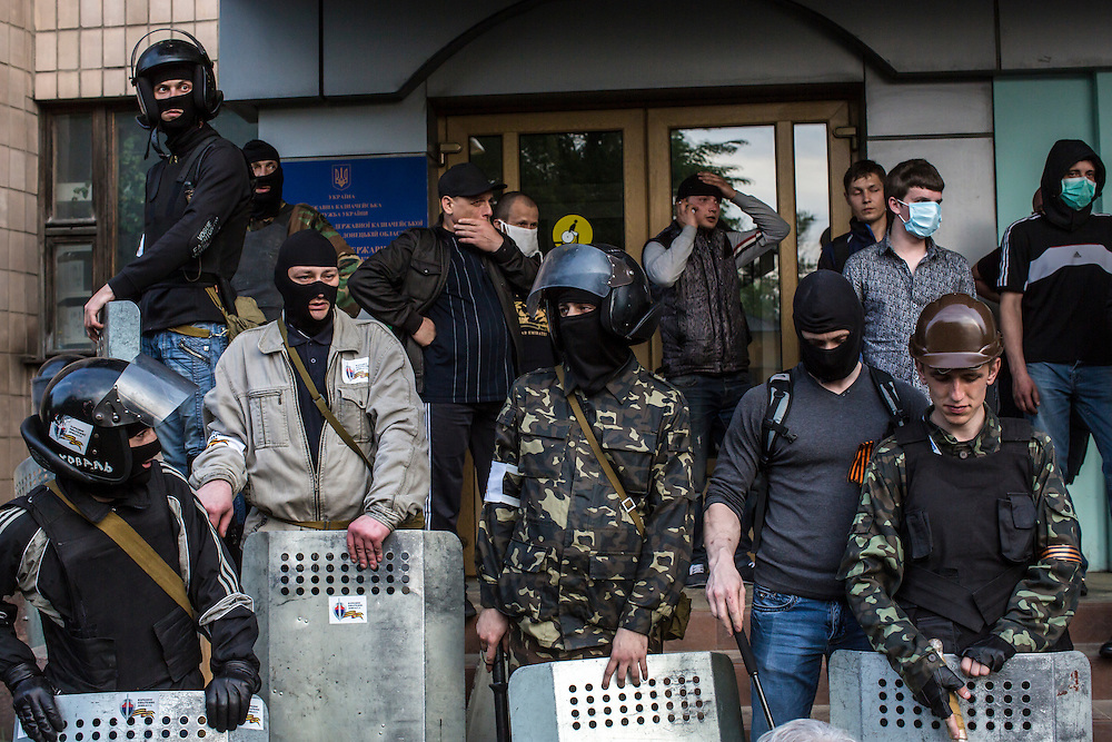 DONETSK, UKRAINE - MAY 4: Pro-Russian protesters stand outside the Executive Council building on May 4, 2014 in Donetsk, Ukraine. Cities across Eastern Ukraine have been overtaken by pro-Russian protesters in recent weeks, leading the Ukrainian military to respond with force in some areas. (Photo by Brendan Hoffman for The Washington Post)