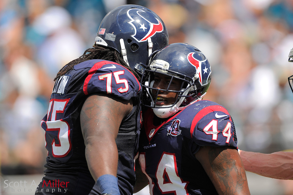 Houston Texans running back Ben Tate (44) celebrates a touchdown with tackle Derek Newton (75) during the Texans 27-7 win over the Jacksonville Jaguars at EverBank Field on September 16, 2012 in Jacksonville, Florida. ..©2012 Scott A. Miller..