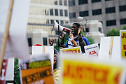 Activist Josh Williams lead a chant during a national march through downtown St. Louis on October 11th, 2014.