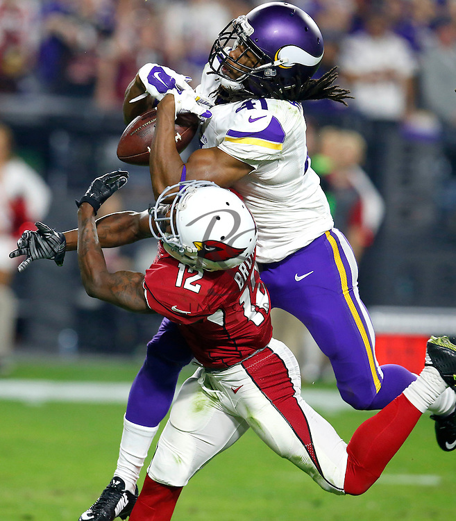 Minnesota Vikings Anthony Harris breaks up a pass intended for Arizona Cardinals wide receiver John Brown (12) during the second half of an NFL football game, Thursday, Dec. 10, 2015, in Glendale, Ariz. (AP Photo/Rick Scuteri)