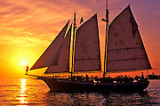 Image of a sailboat at sunset off Mallory Square at Key West, Florida