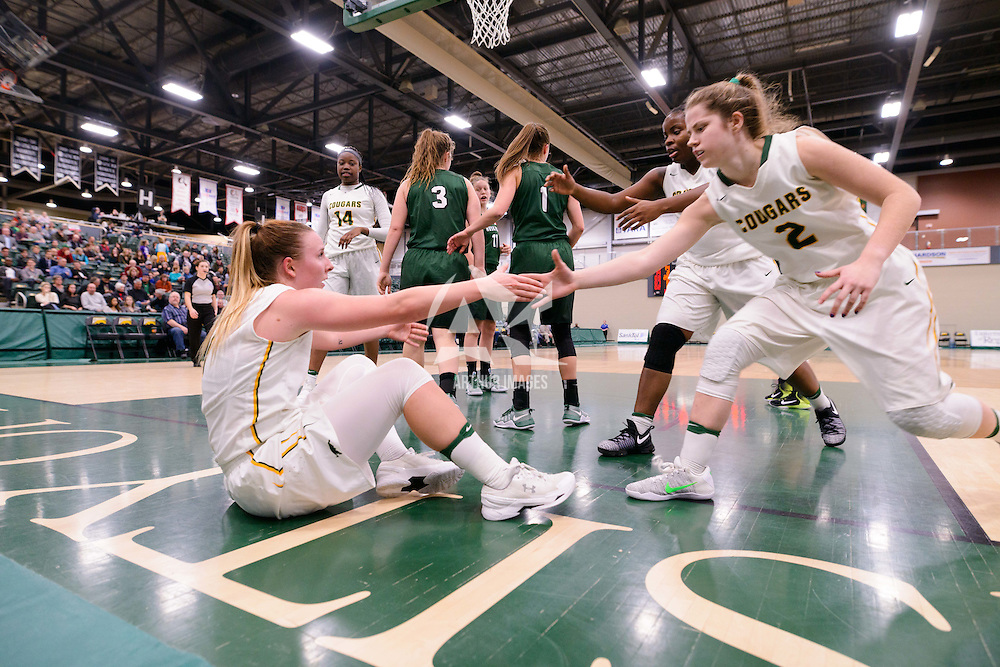 Kyanna Giles and Michaela Kleisinger help teammate Sara Hubenig to her feet during the home game on December  2 at Centre for Kinesiology, Health and Sport. Credit: Arthur Ward/Arthur Images