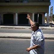 A local resident points, to a group of rebel fighters, the position of a pro-Gaddafi snipper in the buildings accross his house.
