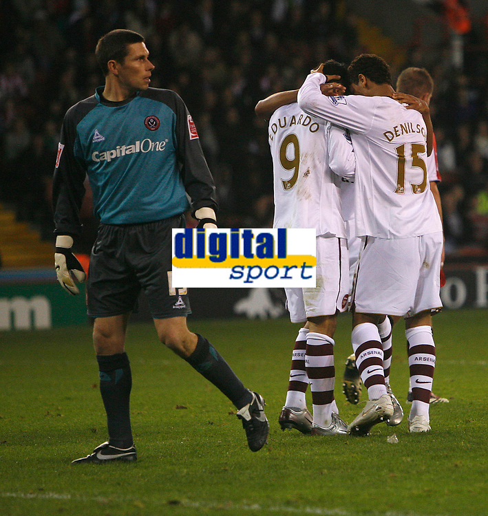 Photo: Steve Bond.<br /> Sheffield United v Arsenal. Carling Cup. 31/10/2007. Eduardo (C) celebrates his 2nd. Keeper Ian Bennett goes to fetch the ball from the net
