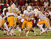 Nov 12, 2011; Fayetteville, AR, USA;  Tennessee Volunteers quarterback Justin Worley (14) looks to hand off the ball as offensive linemen Marcus Jackson (68) tight end Mychal Rivera (81) look to block during a game against the Arkansas Razorbacks at Donald W. Reynolds Razorback Stadium. Arkansas defeated Tennessee 49-7. Mandatory Credit: Beth Hall-US PRESSWIRE