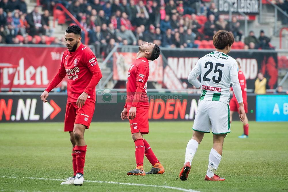 (L-R) Oussama Assaidi of FC Twente, Adam Maher of FC Twente, Ritsu Doan of FC Groningen during the Dutch Eredivisie match between FC Twente Enschede and FC Groningen at the Grolsch Veste on March 04, 2018 in Enschede, The Netherlands